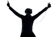 Silhouette man portrait happy listening to music Royalty Free Stock Image