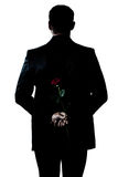 Silhouette man portrait holding a rose flower Royalty Free Stock Photo