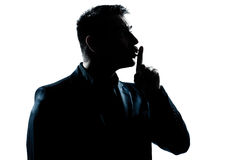 Silhouette man portrait hushing profile Royalty Free Stock Image