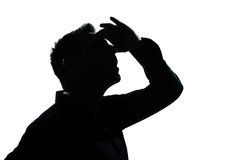 Silhouette man portrait looking up forward gesture Stock Images