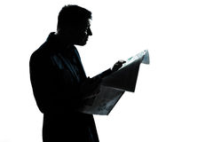 Silhouette man portrait reading newspaper Stock Image