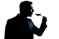 Silhouette man portrait smelling red wine glass Royalty Free Stock Image