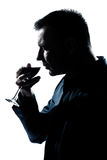 Silhouette man portrait smelling red wine glass Stock Image