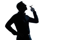 Silhouette man portrait smoking cigarette Royalty Free Stock Photo