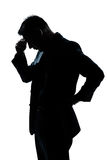Silhouette man portrait thinking looking down Stock Images