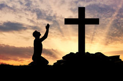 Silhouette of man praying Royalty Free Stock Image