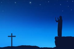 Silhouette of man praying to god with cross shape Royalty Free Stock Photo
