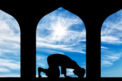Silhouette of man praying at the Town Hall Royalty Free Stock Image