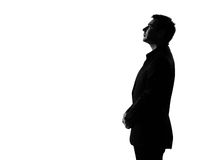 Silhouette  man  profile serious looking up Royalty Free Stock Image