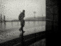 Silhouette of man in rain. In Malta Royalty Free Stock Images
