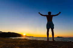 Silhouette of a man with raised arms, freedom concept Stock Images