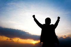 Silhouette of man raising his arms. Success, winning & accomplished concepts Royalty Free Stock Images