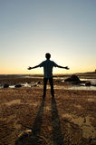 Silhouette of Man Raising His Hands or Open arms Royalty Free Stock Photos