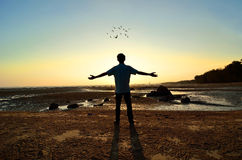 Silhouette of Man Raising His Hands or Open arms Stock Image