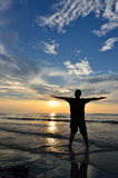 Silhouette of Man Raising His Hands Stock Image