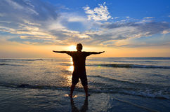 Silhouette of Man Raising His Hands or Open arms Royalty Free Stock Photo