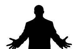 Silhouette of Man Reaching. Silhouette of a man reaching out in front with his hands Stock Image