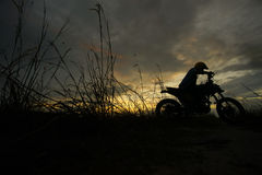 Silhouette of a man riding his motorcycle during sunset. Silhouette of a man riding his motorcycle during sunset Stock Photography