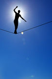 Silhouette of man on the rope concept of risk taking and challen Stock Images