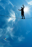 Silhouette of man on the rope concept of risk taking and challen. Man balancing on the rope concept of risk taking vertical image Stock Images
