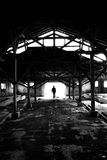 Silhouette man in ruined place. Man silhouette standing in white light at end of at ruined place.(in black white Royalty Free Stock Photo
