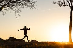 Silhouette of Man Running royalty free stock image