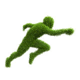 Silhouette of a man running from green leaves Stock Image