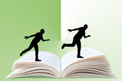 Man running on book Royalty Free Stock Photo