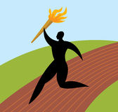 Silhouette man runs with torch Stock Photo