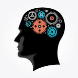 Silhouette of a man`s head with gears in the shape of the brain. The file is saved in the version AI10 EPS Royalty Free Stock Image