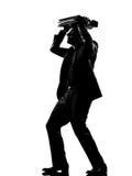 Silhouette  man  shielding with his briefcase Stock Photos