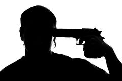 Silhouette of man shooting himself Stock Photo