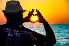 Silhouette of a Man showing love  with fingers Royalty Free Stock Photos