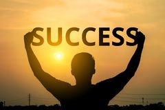Silhouette of a man shows with success text on a sunset background royalty free stock image