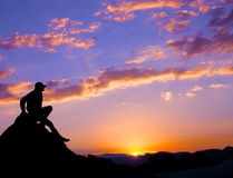Silhouette man sit over the mountain Royalty Free Stock Photos