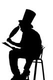 Silhouette man sitting on a stool while writing. In a notebook with a pen Royalty Free Stock Photography