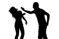 Silhouette of a man slapping a woman Stock Image