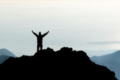 Silhouette of man spreading hand on top of mountain, Mount Rinjani, Lombok island, Indonesia Royalty Free Stock Photography