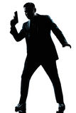 Silhouette man spy holding gun Stock Photography