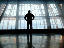 Silhouette of man standing over window. Silhouette of man standing back over big window Stock Photography
