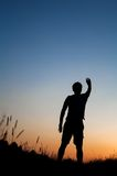 Silhouette of man standing in field royalty free stock images
