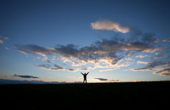 Silhouette of man standing on field Royalty Free Stock Image