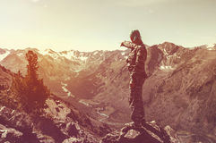 Silhouette of a man standing on the mountain top Stock Images