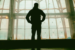 Silhouette of man standing over window. Silhouette of man standing back over big window Stock Photos