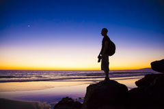 Silhouette of Man Standing in Rock Royalty Free Stock Images