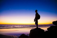 Silhouette of Man Standing in Rock Stock Photography