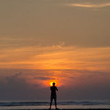 Silhouette of a Man standing at sunrise Stock Image