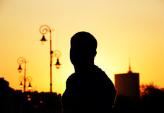 Silhouette of man standing in sunset Stock Photo