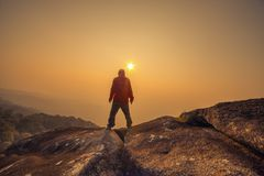 Silhouette man standing into sunset sky Royalty Free Stock Photo