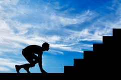 Silhouette of man at the start to step up Stock Images